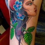 Lady with flowers tattoo