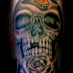 Skull rose and butterfly tattoo