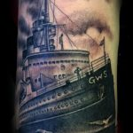 Black and grey ship tattoo