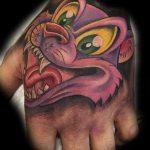 Cartoon cat tattoo