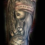 Blindfolded girl and antique timepiece tattoo