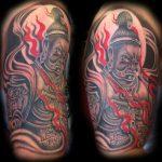 Demonic buddha tattoo