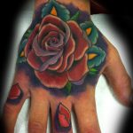 Full colour rose hand tattoo