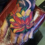 Japanese flower hand tattoo
