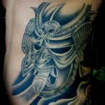 Warrior mask tattoo