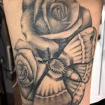 Roses and moth tattoo